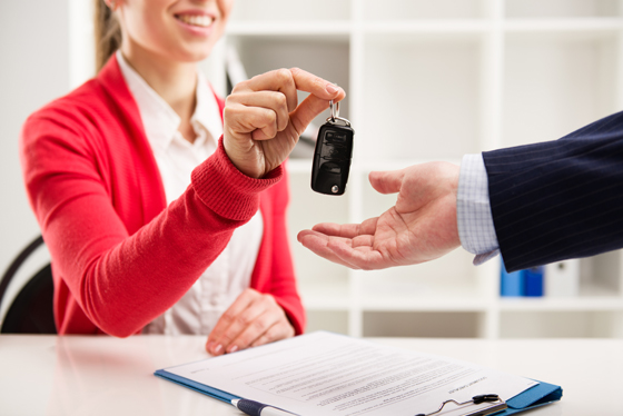 how-to-sell-products-saleswoman-handing-new-car-keys-to-buyer